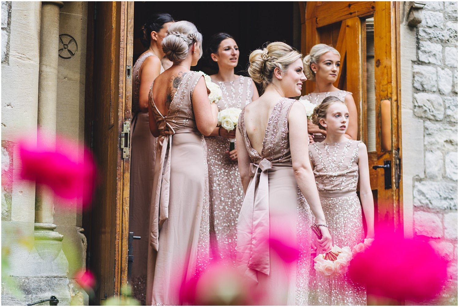 Windsor wedding. Bridesmaids waiting at the St Edwards Catholic church