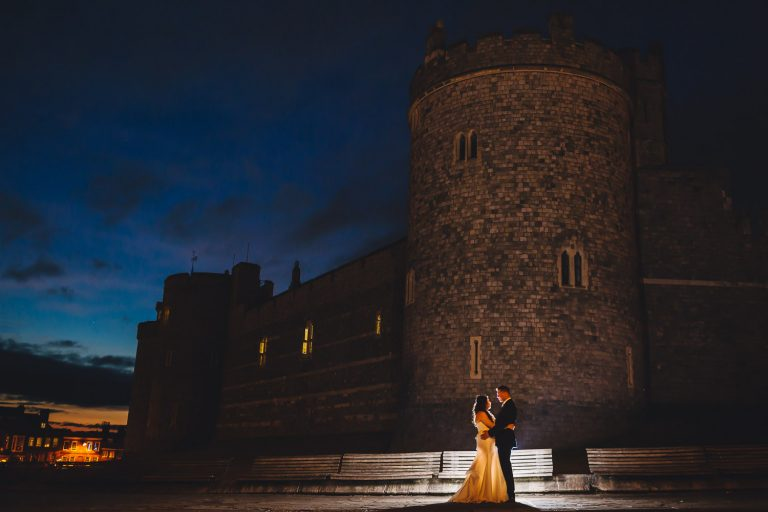 Bride and groom in front of Windsor Castle at night