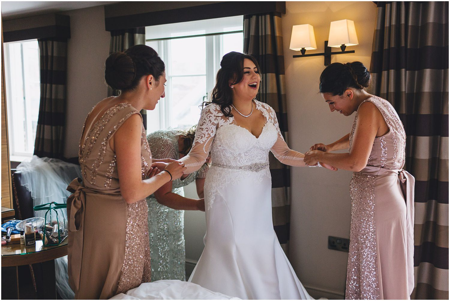Windsor wedding. Bride putting on her dress at the MacDonald Windsor hotel