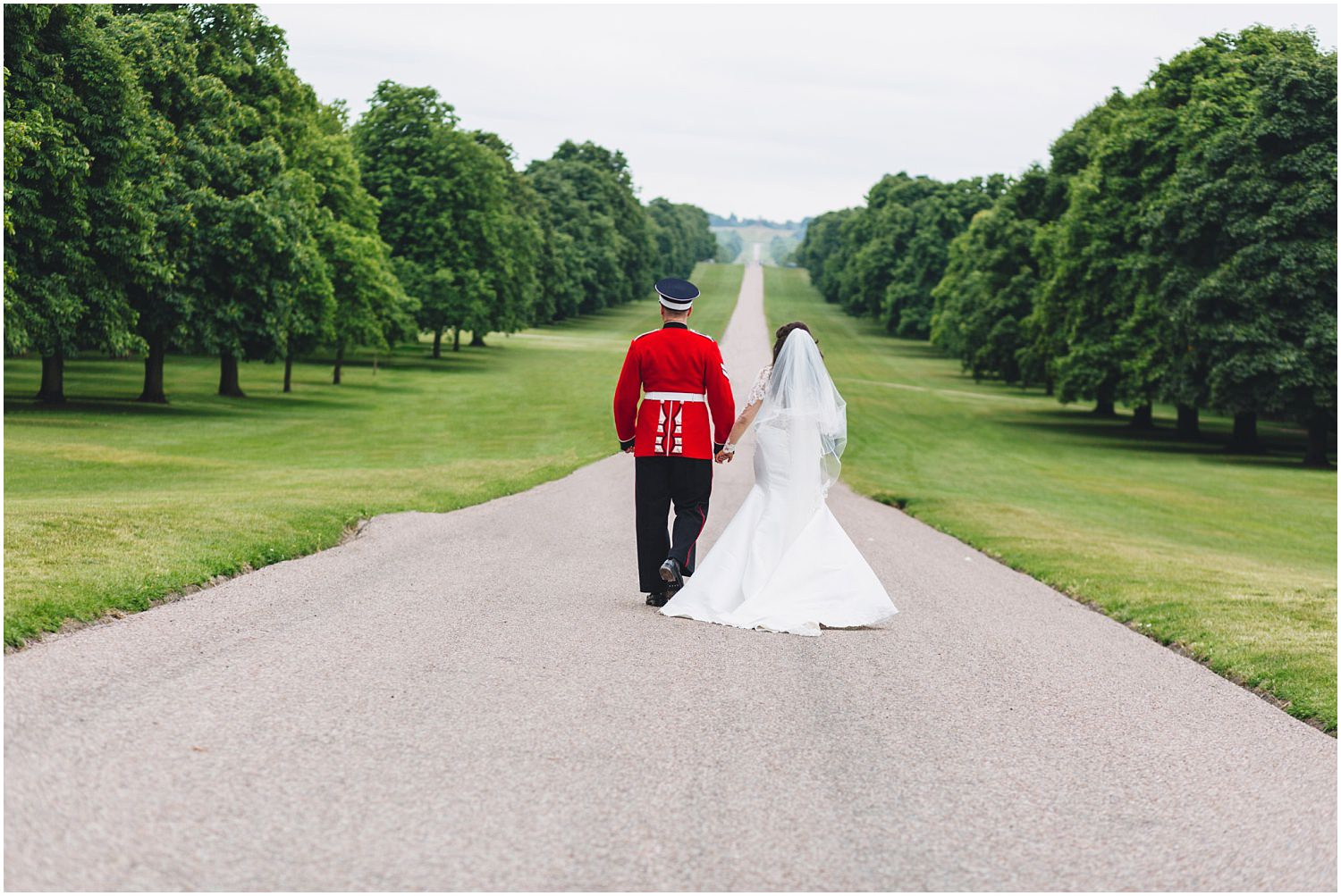 Windsor wedding. Bride and groom walking down the Long Walk