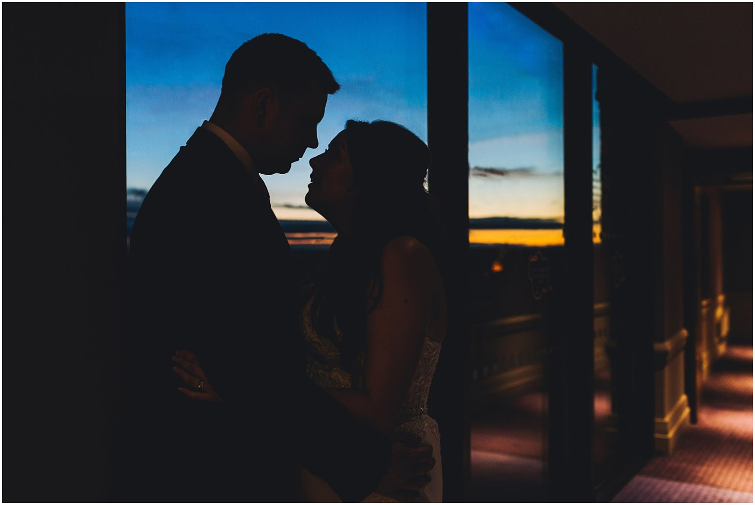 Windsor wedding. Silhouette sunset shot of bride and groom from the MacDonald Windsor hotel