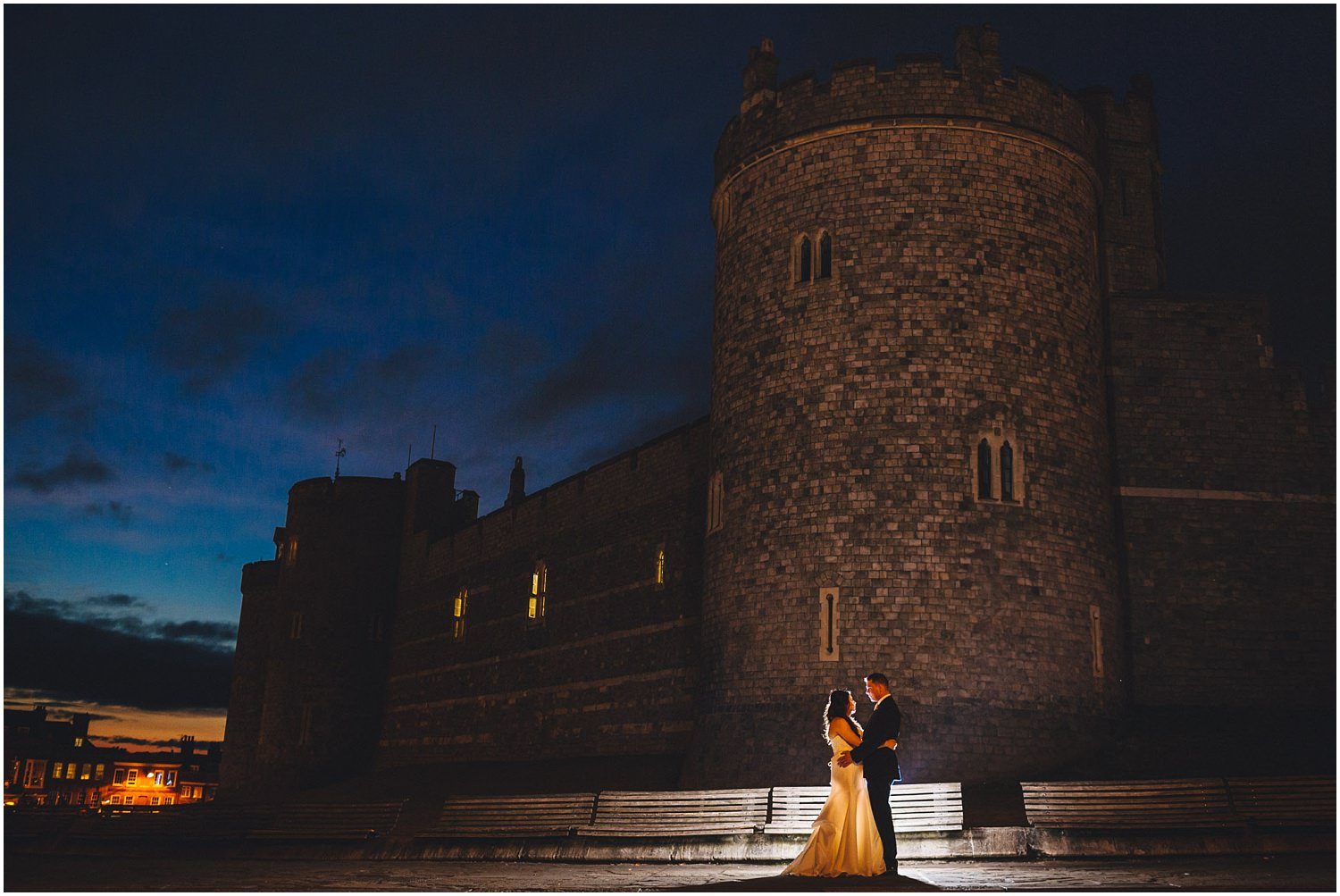 Windsor wedding. Night portrait of bride and groom in front of Windsor castle