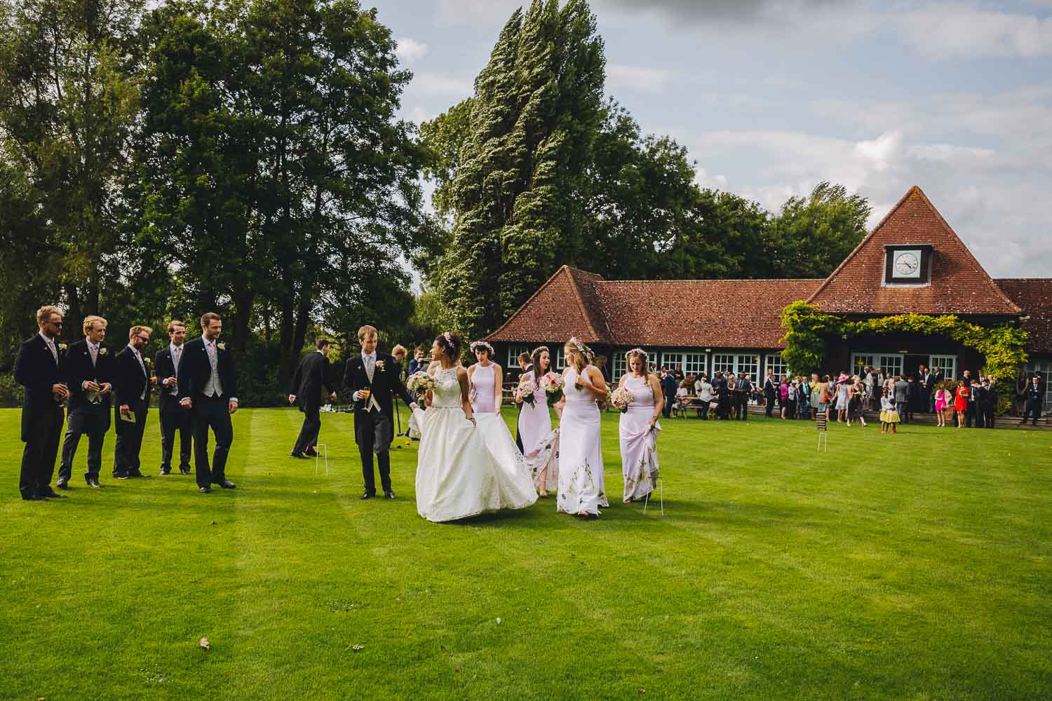 Bridal party walking in the sunshine at Queen's Eyot Island Bray