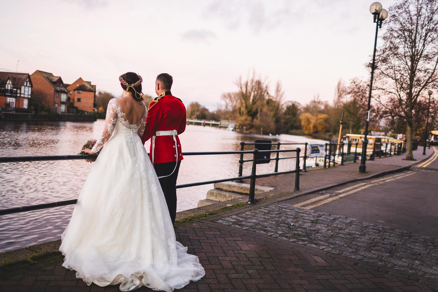 Bride and Household Cavalry groom looking out over the Thames