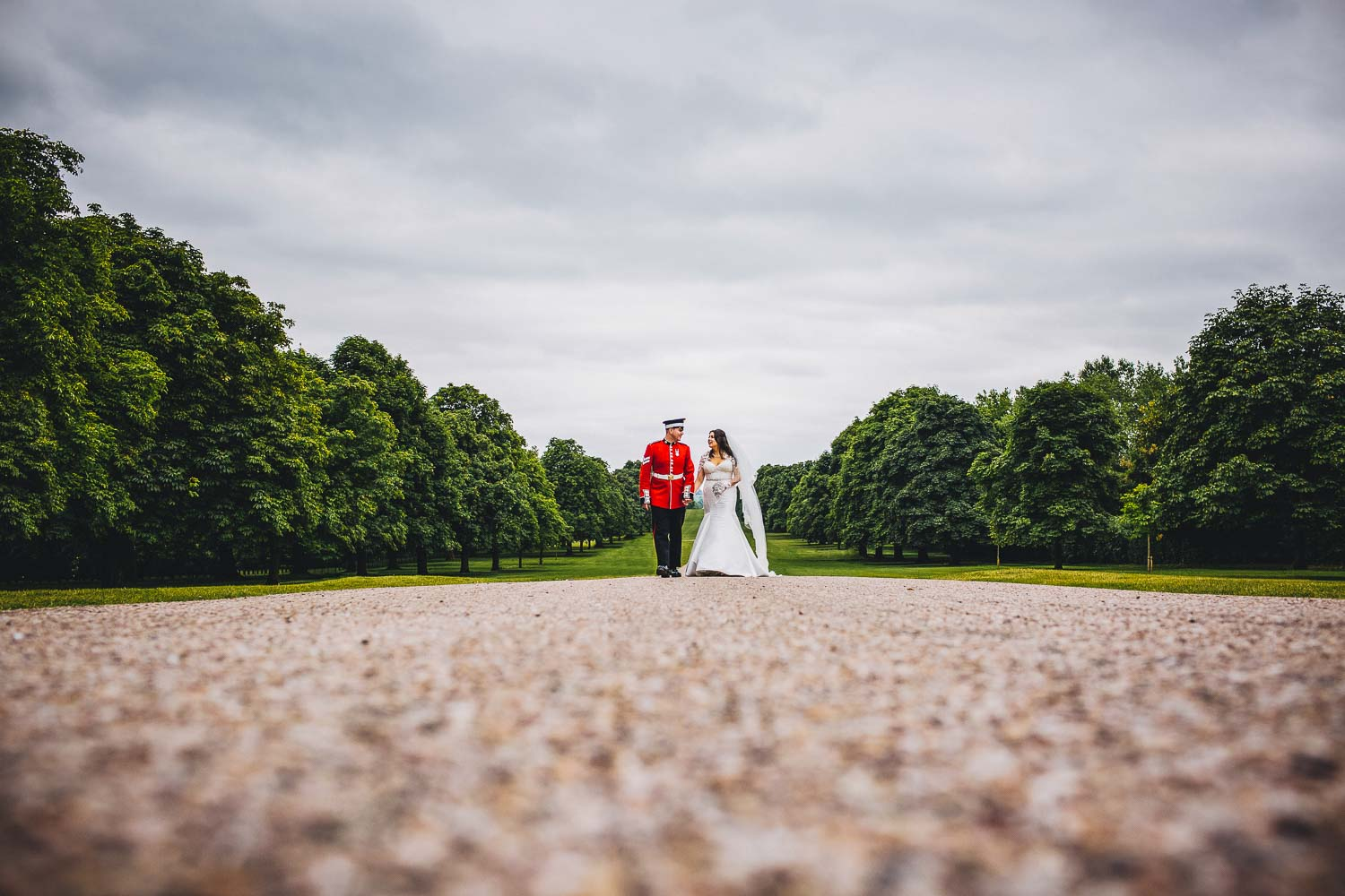 Bride and Coldstream Guard groom walking up the Long Walk in Windsor